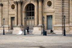 Photographer taking pictures of a bride outside the Louvre Mus Stock Photography