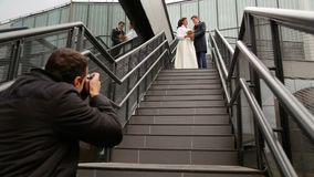 Photographer taking pictures couple of newlyweds stock video