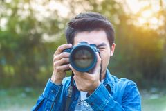 Photographer taking pictures with digital camera. Vintage tone Royalty Free Stock Photos