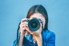 Photographer taking pictures with digital camera. Vintage tone.  Royalty Free Stock Photography