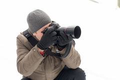 Photographer taking pictures in the forest in winter Stock Image