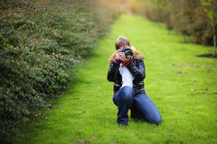 Photographer taking pictures outdoors Royalty Free Stock Images