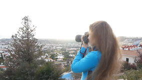 Photographer taking pictures outdoors stock video footage