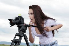 Photographer taking pictures outdoors Royalty Free Stock Photos