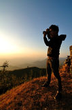 Photographer. A Photographer taking pictures of sundown Stock Images