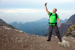 Photographer taking selfie in the mountains Stock Photography