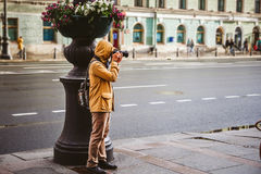 Photographer taking a shot by his camera on street. Travel photography concept Stock Images