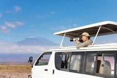 Photographer taking shots of Kilimanjaro mount royalty free stock photography