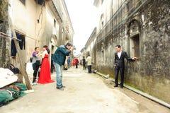Photographer taking wedding photos Stock Images