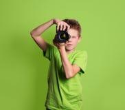 Photographer. Teenage boy using professional camera,  on Stock Photo