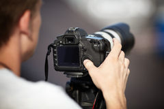 Photographer with Telephoto Lens Stock Images