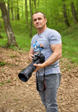 Photographer with telephoto lens on camera Stock Image