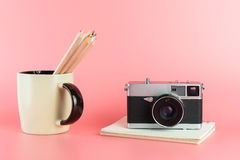 Photographer tools with vintage camera and pencils. Photographer tools with vintage camera and color pencils Stock Photo