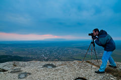 Photographer on top of mountain Stock Photo