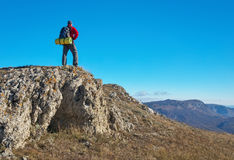 Photographer on top of the mountain in autumn. Royalty Free Stock Photos