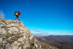 Photographer on top of the mountain in autumn. Royalty Free Stock Photography