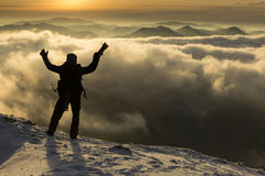 Photographer on top of mountain over the clouds enjoying the vie Royalty Free Stock Photo