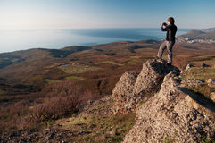 Photographer on the top of world Stock Image