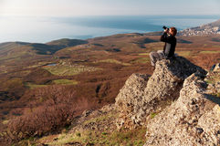 Photographer on the top of world Royalty Free Stock Photo