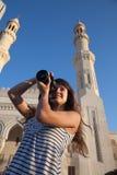 Photographer tourist with photocamera Stock Photos