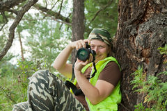 Photographer tourist takes pictures Stock Images