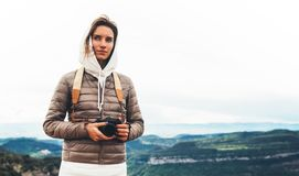 Photographer tourist traveler standing on green top on mountain holding in hands digital photo camera, hiker taking click photogra. Phy, girl enjoy nature stock photos