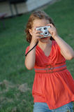 Photographer in training. Young Girl taking a photo Royalty Free Stock Images