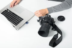 Photographer transferring images from a card Royalty Free Stock Photo