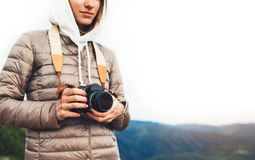 Photographer traveler on green mountain, tourist holding in hands digital photo camera closeup, hiker taking click photography, gi. Rl enjoy nature panoramic stock photos