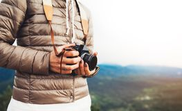 Photographer traveler on green mountain, tourist holding in hands digital photo camera closeup, hiker taking click photography. Girl enjoy nature panoramic royalty free stock photo