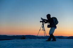 Photographer-traveler makes landscape photo Stock Images