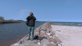 Photographer traveler take photos on the jetty stock footage