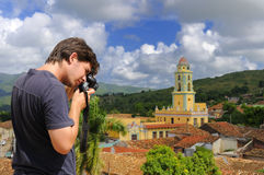 Photographer in Trinidad, cuba. Male photographer taking pictures in Trinidad town, cuba Royalty Free Stock Images