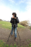 Photographer with tripod Stock Photos