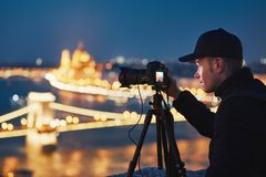 Photographer in the night city Royalty Free Stock Photos