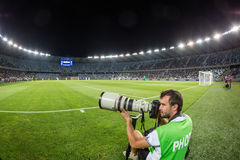 Photographer during the  UEFA Europa League game Royalty Free Stock Photo