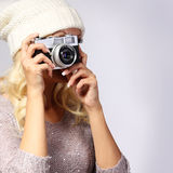 Photographer. Unrecognizable woman taking photo with film camera Stock Image
