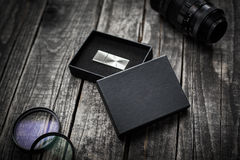 Photographer usb flash stick drive in box mockup Royalty Free Stock Photos