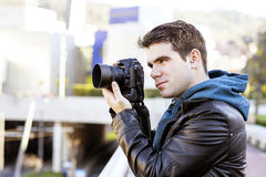 Photographer using camera in public space. Royalty Free Stock Photo