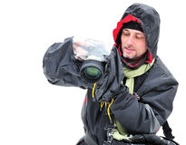 Photographer using camera raincoat in winter Royalty Free Stock Photography