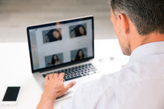 Photographer using laptop Stock Image