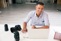 Photographer using laptop Stock Photo