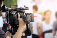 Photographer video recording activity. Within the event Stock Photos