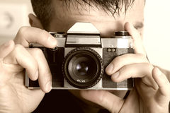 Photographer with vintage camera Stock Image