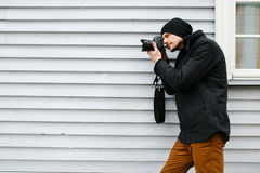 Photographer on walk with a professional camera Stock Photos
