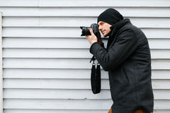 Photographer on walk with a professional camera Royalty Free Stock Images