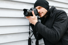 Photographer on walk with a professional camera Stock Photography