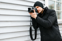 Photographer on walk with a professional camera Royalty Free Stock Photography