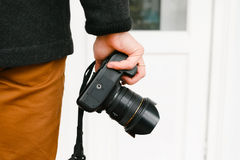Photographer on walk with a professional camera Royalty Free Stock Photo