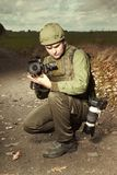 Journalist photographer in war conflict zone Royalty Free Stock Photos